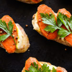 Curried Carrot & Lemony Hummus Crostini