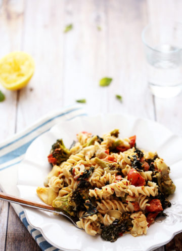 Comforting Kitchen Sink Pasta with Artichokes, Tomatoes, Kale, Broccoli and Vegan Sunflower Seed Alfredo