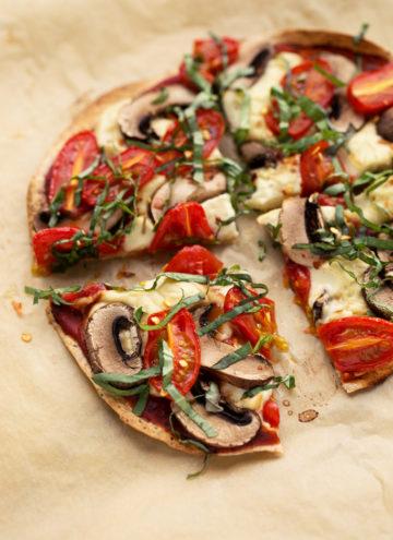 Personal Vegan Tortilla Pizza with Homemade Mozzarella, Mushrooms, Tomatoes, & Basil | Quick, easy, and super crispy!