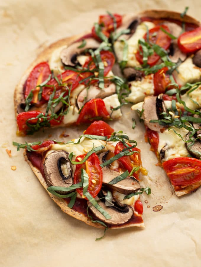 Personal Vegan Tortilla Pizza with Homemade Mozzarella, Mushrooms, Tomatoes, & Basil | Quick, easy, and super crispy!