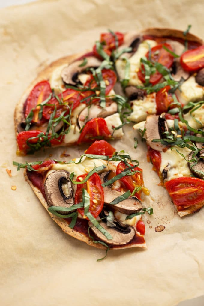 Personal Vegan Tortilla Pizza with Homemade Mozzarella, Mushrooms, Tomatoes, & Basil