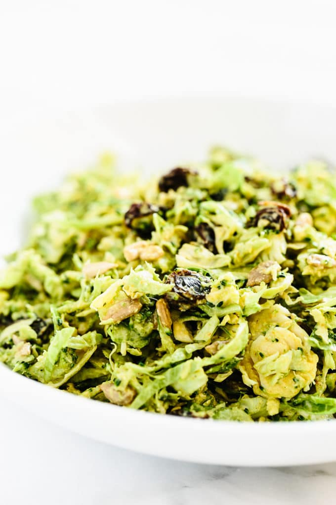 Broccoli & Brussels Sprout Detox Slaw with Creamy Curry Dressing