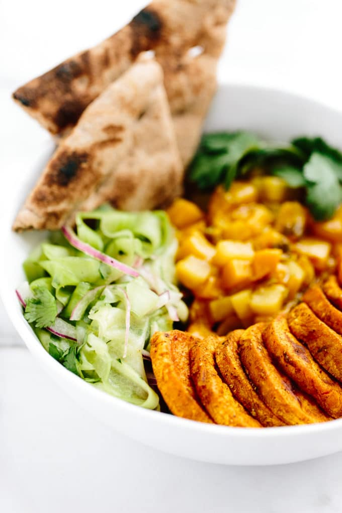 Curried Sweet Potato Power Bowl with Mango-Pear Chutney and Quick Pickled Cucumber Salad