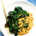 Vegan Parmesan Farro Risotto with Garlicky Greens