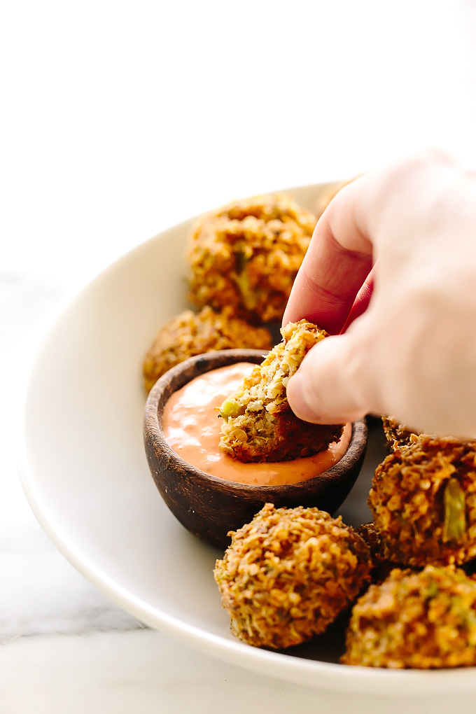 These vegan cheesy broccoli quinoa bites with sriracha aioli are hearty, flavorful, and totally snack-worthy. They make a crowd-pleasing appetizer and are also a hit with little ones, too (skip the aioli).